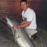 Son Bill catches sandbar shark from the beach