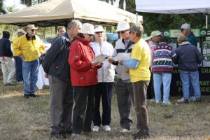 Volunteer Lucia Schattelyn (yellow shirt) talks with visitors