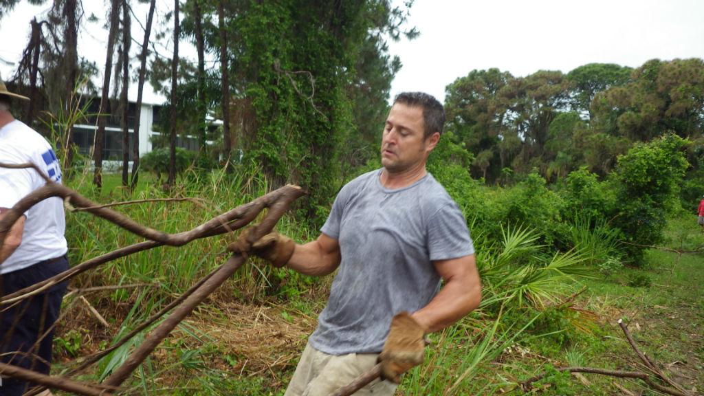 Mark Grossenbacher hauls away debris.